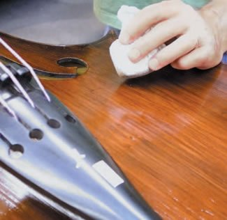 Wiping your bass down after use to remove rosin from its top will keep it looking good.